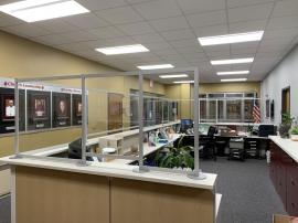 Custom Office Safety Partitions for a Large Administrative Counter Constructed with Engineered Aluminum and Clear Acrylic